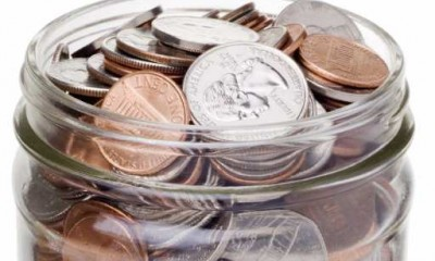 A jar full of coins.  With clipping path.
