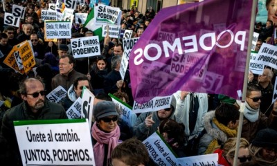 MADRID, SPAIN - JANUARY 31:  People hold up banners during a march of Podemos (We can) political party on January 31, 2015 in Madrid, Spain. According to the last opinion polls Podemos (We Can), the anti-austerity left-wing party emerged out of popular movements and officially formed last year, has wider support than the traditional parties of Spain, the Spanish Prime Minister's right-wing party Partido Popular and the main opposition party, the Socialist (PSOE). Spain will hold General Elections this year by the end of November.  (Photo by David Ramos/Getty Images)