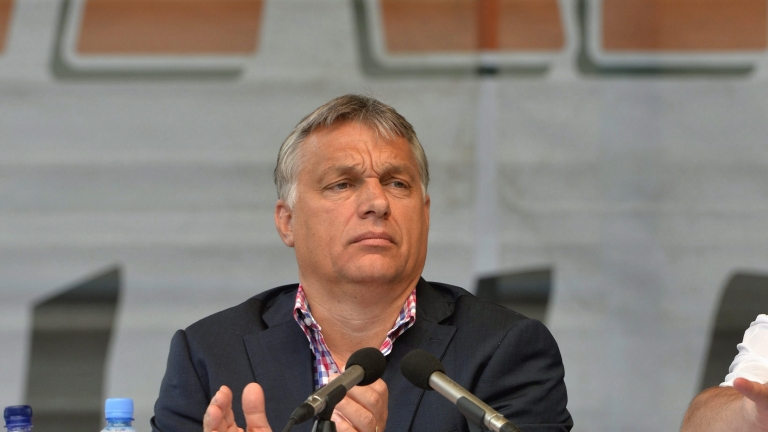 epa05437595 Hungarian Prime Minister Viktor Orban delivers his speech during the 27th Balvanyos Summer University and Students' Camp in Baile Tusnad, central Romania 23 July 2016. The week-long Balvanyos Summer University and Camp is held annually since 1990 and it's one of the most important national political workshops of Hungary's governing Fidesz - Hungarian Civic Alliance. This is the biggest public forum of Hungary's dialogue with the ethnic Hungarian minority and with Romania. Beyond the lectures and roundtables there are rich variety of cultural programmes, including plenty of concerts in each year.  EPA/ZOLTAN MATHE HUNGARY OUT
