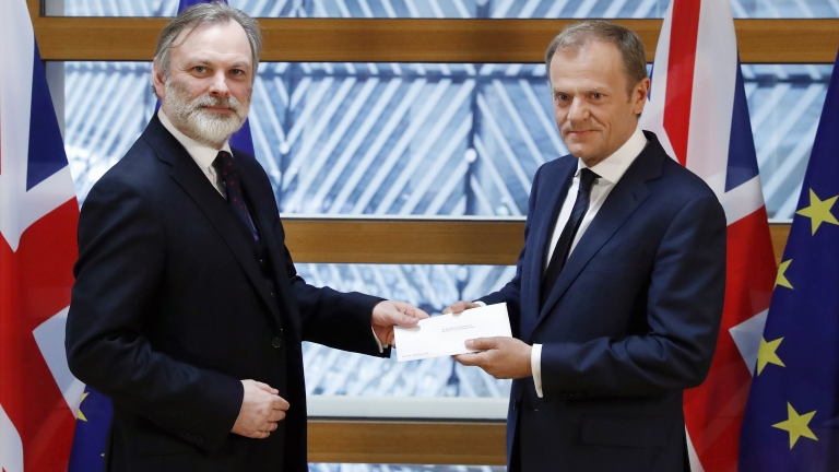 epa05876934 British ambassador to the EU, Sir Tim Barrow (L) delivers the official notice under Article 50 of the Lisbon Treaty to European Council President Donald Tusk in Brussels, Belgium, 29 March 2017, as part of the process that starts the formal proceedings of United Kingdom leaving the European Union. Britain's Prime Minister earlier in the day signed the notice, following the June 2016 referendum to vote on Britain staying or leaving the European Union.  EPA/YVES HERMAN / POOL