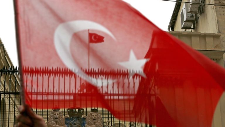 epa05843834 A Turkish flag flies on the roof of  the Dutch Consulate during a protest in Istanbul, Turkey 12 March 2017. Turkish Family Minister Fatma Betul Sayan Kaya was barred by police from entering the Turkish consulate in Rotterdam on 11 March, after the Dutch government had denied landing rights to Turkish Foreign Minister Cavusoglu who planned a speech at the consul's residence in Rotterdam. The incidents have led to a diplomatic row between the two countries, and protests by Turkish citizens in the Netherlands as well as in Turkey.  EPA/CEM TURKEL