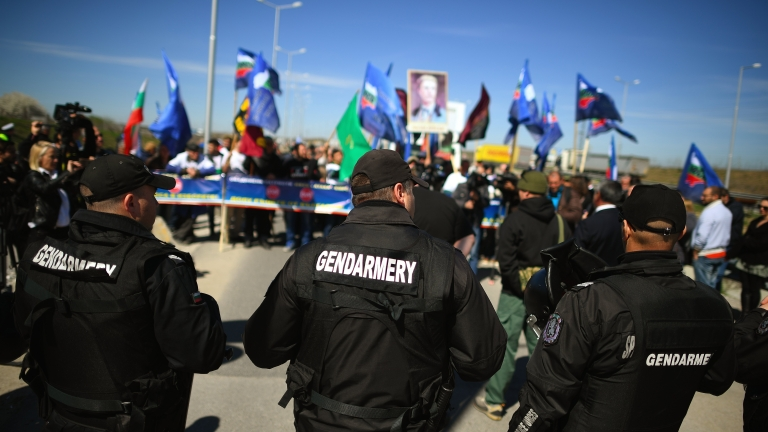 epa05867556 Bulgarian police officers keep watch as supporters of the Bulgarian National-Patriotic Party block the border between Bulgaria and Turkey, at the Kapitan Andreevo check point, some 350km south-east of Sofia, Bulgaria, 24 March 2017. About 150 ultra-nationalists blocked the main checkpoint between Turkey and Bulgaria, in Kapitan Andreevo, to prevent, as they say, buses transporting voters of double nationality, Bulgarian and Turkish, to participate in the parliamentary elections on 26 March. The organizers of the protest, members of the Patriots United nationalist electoral alliance in Bulgaria (VMRO, National Front for Salvation of Bulgaria and Ataka), repeated the blocking as they organized a similar demonstration a few days earlier and promised to maintain it till election day. From the beginning of March there has been increasing tensions between Bulgaria and Turkey due to various Turkish officials calls to vote for certain ethnic Turkish parties in Bulgaria, a move condemned by Sofia as interference in internal affairs.  EPA/VASSIL DONEV