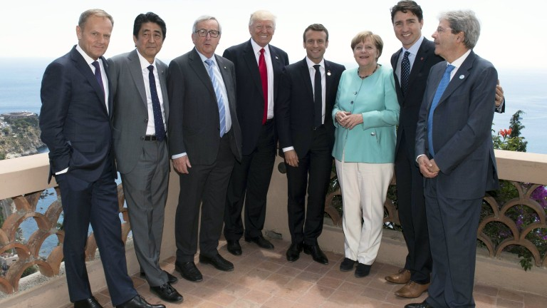 epa05992914 A handout photo made available by the Chigi Palace Press office on 27 May 2017 shows the G7 and Europe leaders with (L-R) European Council President Donald Tusk, Japanese Prime Minister Shinzo Abe, European Commission President Jean-Claude Juncker, US President Donald J. Trump, French President Emmanuel Macron, German Chancellor Angela Merkel, Canada's Prime Minister Justin Trudeau and hosting Italian Prime Minister Paolo Gentiloni standing together for a group photo during the G7 Summit extended session in the Sicilian town of Taormina, Italy, on its second day on 27 May 2017. The second day is scheduled to deal with Innovation and Development in Africa, Global Issues such as Human Mobility, Food Security and Gender Equality as well as the G7 Global Relations,  the Italian G7 Presidency said in a media release.  EPA/TIBERIO BARCHIELLI/CHIGI PRESS OFFICE HANDOUT  HANDOUT EDITORIAL USE ONLY/NO SALES