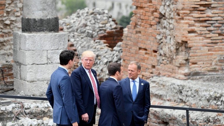 epa05991216 (L-R) Canadian Prime Minister Justin Trudeau, US President Donald J. Trump, French President Emmanuel Macron and EU Council President Donald Tusk leave after having posed for the group photo on the first day of the G7 Summit at the Teatro Greco in Taormina, Italy, 26 May 2017. Heads of States and of Governments of the G7, the group of most industrialized economies, plus the European Union, meet in Taormina, Italy, from 26 to 27 May 2017 for a summit titlked 'Building the Foundations of Renewed Trust' which is aimed at discussing 'citizen safety, economic, environmental and social sustainability and the reduction of inequalities' as well as 'innovation, skills and labor in the age of the Next Production Revolution', the Italian G7 Presidency said in a media release.  EPA/ETTORE FERRARI