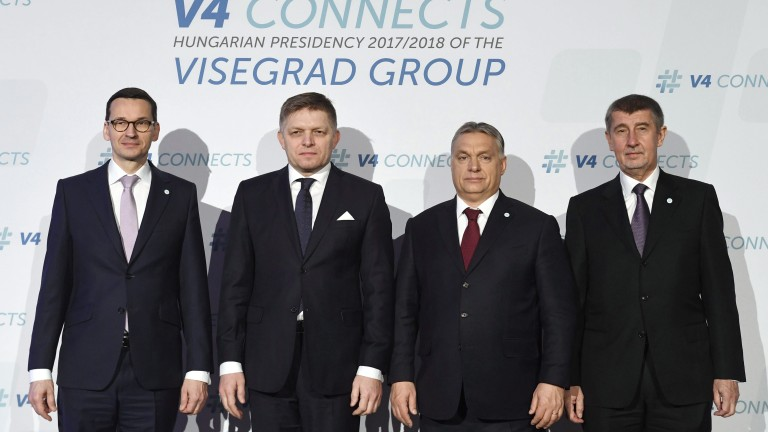 epa06475151 (L-R) Polish Premier Mateusz Morawiecki, Slovakian Premier Robert Fico, Hungarian Prime Minister Viktor Orban and interim Prime Minister of the Czech Republic Andrej Babis pose for a group photo prior to the meeting of the Heads of Government of the Visegrad Group (V4) countries in Varkert Bazaar in Budapest, Hungary, 26 January 2018.  EPA/Szilard Koszticsak HUNGARY OUT
