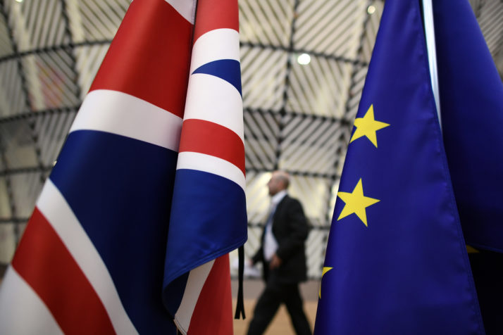 BRUSSELS, BELGIUM - MARCH 09:  A man walks past British and European Union flags in the arrival area of the Europa building at the Council of the European Union on the first day of an EU summit, on March 9, 2017 in Brussels, Belgium. EU leaders will gather for a two-day summit to discuss a number of issues including Great Britain's exit from the Union.  (Photo by Carl Court/Getty Images)