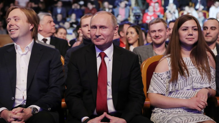 epa06593212 Russian President Vladimir Putin (C) and KVN Premier League host Alexander Maslyakov Jr. (L) attend the round of 16 of the premier league of KVN International Union at the Russian Army Theater in Moscow, Russia, late 09 March 2018, (issued 10 March 2018).. KVN ('Club of the Funny and Inventive People' ) - television humorous games in which teams of various collectives (educational institutions, universities, enterprises, cities, etc.) compete by giving funny answers to questions and showing prepared sketches, that originated in the Soviet Union. The first program appered on the First Soviet TV Channel 08 November 1961.  EPA/MIKHAIL KLIMENTYEV/SPUTNIK/KREMLIN POOL MANDATORY CREDIT