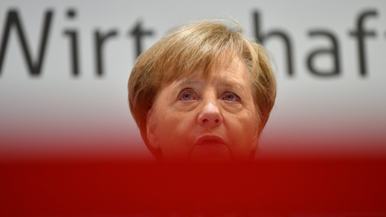 epaselect epa06591312 German Chancellor Angela Merkel of the Christian Democratic Union (CDU) speaks at a press conference after the Munich economic talks in Munich, Germany, 09 March 2018. The talks are a high level conference with representatives of German employer and trade associations that is held annually during the international trade fair in Munich.German Chancellor Angela Merkel of the Christian Democratic Union (CDU) speaks during the Munich economic talks in Munich, Germany, 09 March 2018.  EPA/PHILIPP GUELLAND