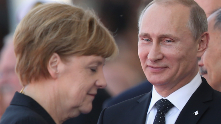 OUISTREHAM, FRANCE - JUNE 06:  In this file photo German Chancellor Angela Merkel and Russian President Vladimir Putin attend commeoration ceremonies marking the 70th anniversary of the D-day invasion of Nazi-occupied Normandy on June 6, 2014 in Ouistreham, France. Merkel and other leaders of NATO-member states are attending a NATO summit in Newport, Wales, from September 4-5, 2014, and Russia's active involvement in the war in eastern Ukraine is high on the summit agenda.  (Photo by Sean Gallup/Getty Images)