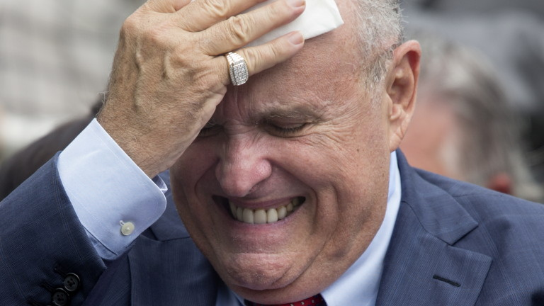 epaselect epa06774507 Attorney to US President Donald J. Trump Rudy Giuliani wipes his brow before the start of the White House Sports and Fitness Day at the South Lawn of the White House in Washington, DC, USA, 30 May 2018.  EPA/MICHAEL REYNOLDS