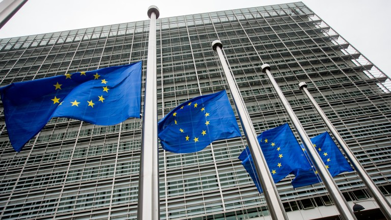 epa06149667 European Union flags fly at half-mast in honour of the victims of the 17 August terrorist attack in Barcelona, Spain, in front of the seat of the European Commission in Brussels, Belgium, 18 August 2017. According to media reports, at least 13 people have died and 100 were injured when a van crashed into pedestrians in Las Ramblas in Barcelona in an incident which Spanish police are treating as a terror attack. A similar attack was conducted in the coastal city of Cambrils, where five alleged terrorists, who apparently wore bomb belts, were shot dead by security forces on early morning 18 August after they attacked pedestrians using a vehicle next to a promenade, injuring seven people, including a police officer. Police have stated that the attack in Barcelona and the attack in Cambrils were linked. The so-called 'Islamic State' (IS) has claimed responsibility for the attack in Barcelona.  EPA/STEPHANIE LECOCQ