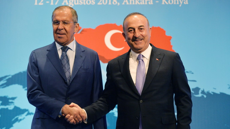 epa06948629 Turkish Foreign Minister Mevlut Cavusoglu (R) shakes hands with Russian Foreign Minister Sergei Lavrov (L) during their meeting at the 10th Ambassador Conference in Ankara, Turkey, 14 August 2018.  EPA/STR