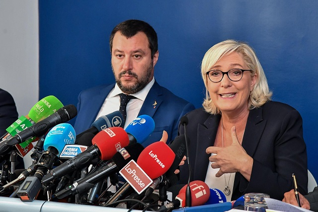 "Far-right leader Marine Le Pen, right, and Italian Interior Minister and Deputy Premier, Matteo Salvini, smile before the start of the meeting ""economic growth and social prospects in a Europe of nations, in Rome, Monday, Oct. 8, 2018. (Alessandro Di Meo/ANSA via AP)"