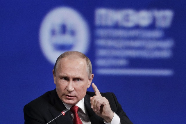 "FILE - In this Friday, June 2, 2017, file photo, Russian President Vladimir Putin gestures as he speaks at the St. Petersburg International Economic Forum in St. Petersburg, Russia. Putin is dismissing as ""a load of nonsense"" the idea that Russia has damaging information on President Donald Trump and denies having any relationship with him, said Putin in an interview with NBC's ""Sunday Night with Megyn Kelly."" (AP Photo/Dmitry Lovetsky, File)"