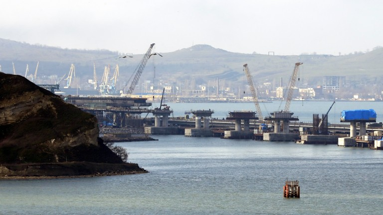 epa06603588 A general view over the construction site of the Crimean Bridge over the Kerch Strait in Russia, 14 March 2018. The 19-kilometres-long road and rail bridge will connect by the end of 2018.  The Crimean peninsula which was annexed by Russia from Ukraine in March 2014. The motorway section is to be put into operation in December 2018 and the railway section is expected to be launched in 2019.  EPA/YURI KOCHETKOV