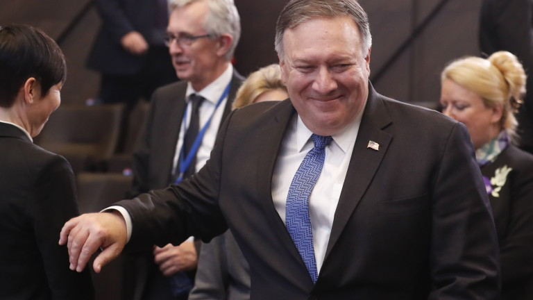 epa07208149 US Secretary of State Mike Pompeo (R), attends the first day of Nato Foreign ministers council at Alliance headquarters in Brussels, Belgium, 04 December 2018. First working session focus on North Atlantic Council relation with Georgia and Ukraine.  EPA/OLIVIER HOSLET