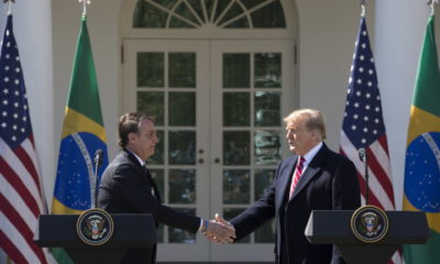 epa07448989 US President Donald J. Trump (R) and Brazilian President Jair Bolsonaro (L) shake hands at the conclusion of their joint news conference in the Rose Garden of the White House in Washington, DC, USA, 19 March 2019. Bolsonaro, a right-wing nationalist who earned the nickname the 'Trump of the Tropics,' met with President Trump for bilateral negotiations and a joint press conference.  EPA/MICHAEL REYNOLDS