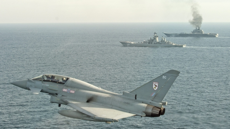 epa05749035 A handout photo made available 25 January 2017 by the British Ministry of Defence showing a Royal Air Force Typhoon shadowing  Russian Warships Petr Velikiy (centre) and the Admiral Kuznetsov (background) in the North Sea 24 January. . Typhoon aircraft were launched to monitor the Russian warships as they transit close to UK sovereign waters in order to ensure that their activity is monitored and executed safely in accordance with international procedures.  EPA/MOD Crown Copyright 2017 HANDOUT  HANDOUT EDITORIAL USE ONLY/NO SALES