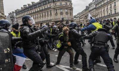 gilets-jaunes-france-protests-paris-police-yellow-vests