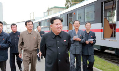 epa04990345 An undated picture released by the Rodong Sinmun, the newspaper of the ruling Workers Party, on 23 October 2015 shows North Korean leader Kim Jong-un (C) views a newly manufactured metro car during a visit to a train-making plant, in Pyongyang, North Korea.  EPA/Rodong Sinmun SOUTH KOREA OUT -- BEST AVAILABLE QUALITY