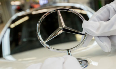 STUTTGART, GERMANY - JANUARY 24:  An employee mounts a Daimler AG Mercedes-Benz emblem to the hood of a S-Class sedans at the Mercedes-Benz plant on January 24, 2018 in Sindelfingen, Germany. Daimler AG, which owns the Mercedes-Benz brand, will host its annual press conference to present financial results for 2017 on February 1. Daimler produces S-class and E-class cars at the Sindelfingen facility.  (Photo by Thomas Niedermueller/Getty Images)