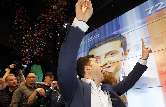 epa07520381 Ukrainian showman and comedian, and Presidential candidate Volodymyr Zelensky reacts at his campaign headquarters following a presidential elections in Kiev, Ukraine, on April 21, 2019. Ukrainians voted during the second round of Presidential elections on 21 April 2019.  EPA/STEPAN FRANKO