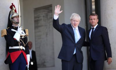 epa07785598 French President Emmanuel Macron (R) and British Prime Minister Boris Johnson (L) prior to their  meeting at the Elysee Palace in Paris, France, 22 August 2019. Johnson is in Paris after a one day visit in Berlin.  EPA/CHRISTOPHE PETIT TESSON