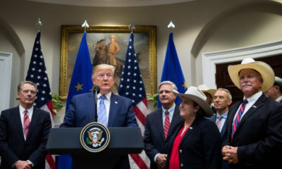 epaselect epa07753986 US President Donald J. Trump, speaks alongside US Trade Representative Robert Lighthizer (L), Sen. John Hovan, R-ND, and members of the beef industry as he announces a US beef trade deal with the European Union, in the Roosevelt Room at the White House in Washington, DC, USA, 02 August 2019.  EPA/KEVIN DIETSCH / POOL