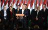 Hungarian Prime Minister Viktor Orban, center, speaks during the Fidesz-KDNP's event after the nationwide local elections in Budapest, Hungary, Sunday, October 13, 2019. From second right Outgoing Mayor of Budapest and candidate of the governing Fidesz-KDNP party Istvan Tarlos is seen. (Szilard Koszticsak/MTI via AP)