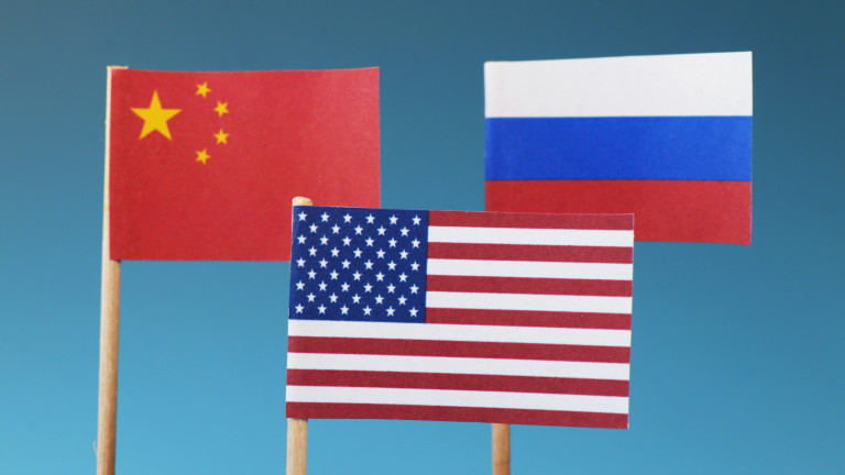 The main states on business war. The states who have main world in whole world. China, Russia, America and their flags. Blue background