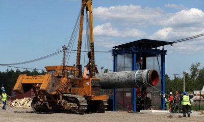 """LENINGRAD REGION, RUSSIA - JUNE 5, 2019: The construction site of a section of the Nord Stream 2 natural gas pipeline near Kingisepp, Leningrad Region. Alexander Demianchuk/TASS  Ðîññèÿ. Ëåíèíãðàäñêàÿ îáëàñòü. Íà ñòðîèòåëüíîé ïëîùàäêå ó÷àñòêà ãàçîïðîâîäà """"Ñåâåðíûé ïîòîê - 2"""" â ðàéîíå Êèíãèñåïïà. Àëåêñàíäð Äåìüÿí÷óê/ÒÀÑÑ"""