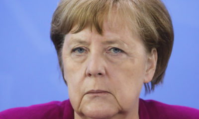 German Chancellor Angela Merkel briefs the media after a meeting with German federal state governors at the chancellery in Berlin, Germany, Wednesday, May 27, 2020. (AP Photo/Markus Schreiber, Pool)